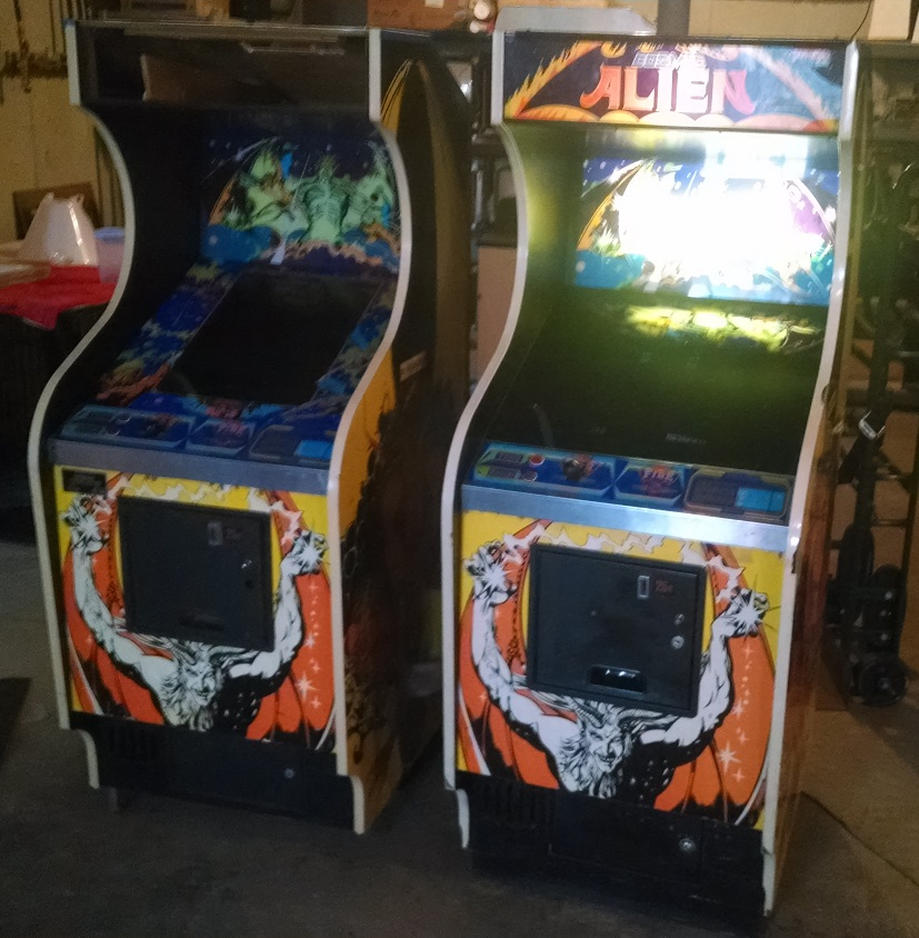 Two Cosmic Alien arcade games, side by side